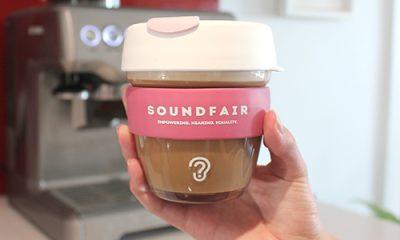 A Soundfair keepcup, full of coffee