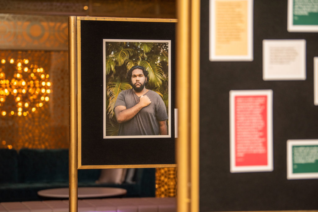 Some of the portraits at the HearMe event were mounted on  walls, with stories of lived experience.